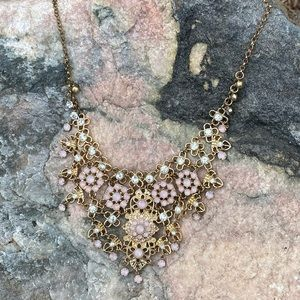 Statement necklace with gold, rhinestone, pink